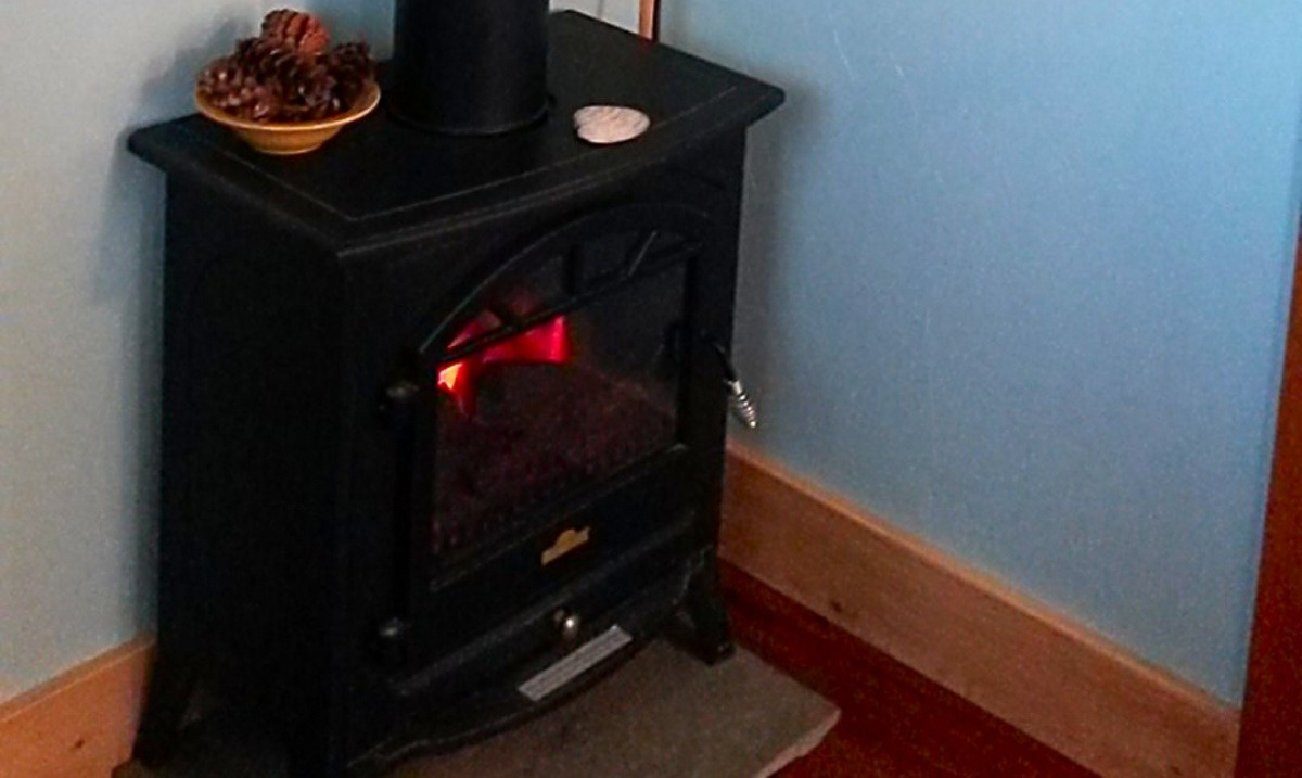 Electric wood stove adds cozy and homey atmosphere